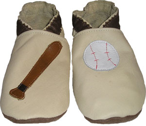 All Tan leather crib shoe with baseball bat and baseball.