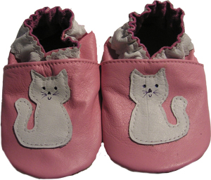 Pink shoe with full sized Cat Crib Shoe