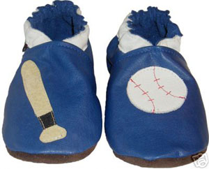 Get ready for baseball season in this blue crib shoe with baseball bat and ball.